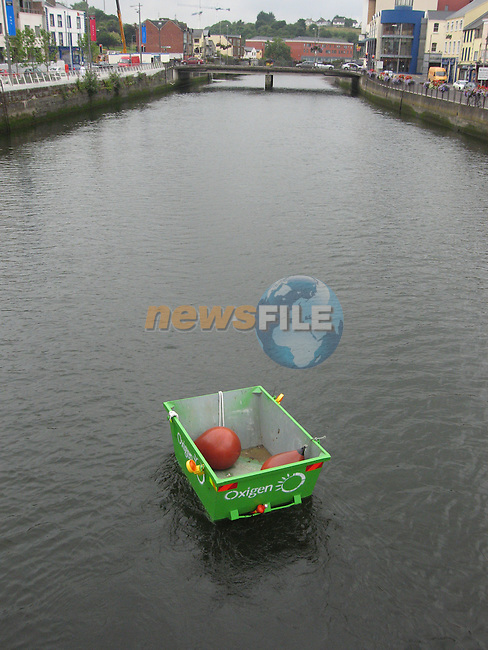 A Skip in the river boyne but what has to be cleaned up.Photo: Fran Caffrey/ Newsfile.