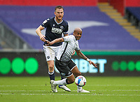 3rd October 2020; Liberty Stadium, Swansea, Glamorgan, Wales; English Football League Championship, Swansea City versus Millwall; Andre Ayew of Swansea City controls the ball while under pressure from Alex Pearce of Millwall