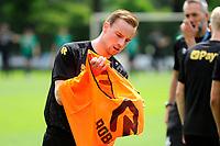 GRONINGEN - Voetbal, Eerste training selectie FC Groningen, seizoen 2021-2022, 26-06-2021, FC Groningen speler Romano Postema trekt een hesje aan