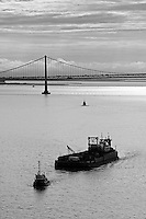 aerial photograph of tug boat pulling barge San Francisco Oakland Bay Bridge