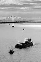 aerial photograph of tug boat pulling barge San Francisco Oakland Bay Bridge
