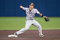 Oakland Golden Grizzlies second baseman Ian Yetsko (16) turns a double play against the Michigan Wolverines on May 17, 2016 at Ray Fisher Stadium in Ann Arbor, Michigan. Oakland defeated Michigan 6-5 in 10 innings. (Andrew Woolley/Four Seam Images)