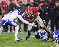 ATHENS, GA - OCTOBER 19: D'Andre Swift #7 of the Georgia Bulldogs makes a run and Jordan Griffin #3 of the Kentucky Wildcats attempts to tackle him.  Swift evaded his tackle and ran for a touchdown. during a game between University of Kentucky Wildcats and University of Georgia Bulldogs at Sanford Stadium on October 19, 2019 in Athens, Georgia.