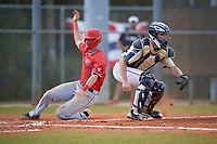 Mount St. Mary's Mountaineers catcher Zack Costello (18) waits for a throw as Ryan Peltier (7) slides home during a game against the Ball State Cardinals on March 9, 2019 at North Charlotte Regional Park in Port Charlotte, Florida.  Ball State defeated Mount St. Mary's 12-9.  (Mike Janes/Four Seam Images)