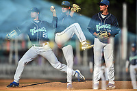 Asheville Tourists starting pitcher Nick Bush (29) delivers a pitch in an in-camera multiple exposure during a game against the Rome Braves at McCormick Field on July 20, 2019 in Asheville, North Carolina. The Tourists defeated the Braves 3-2. (Tony Farlow/Four Seam Images)