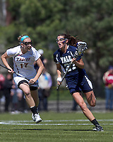 Yale University midfielder Christina Doherty (27) brings the ball forward as Boston College midfielder Mikaela Rix (17) defends. Boston College defeated Yale University, 16-5, at Newton Campus Field, April 28, 2012.