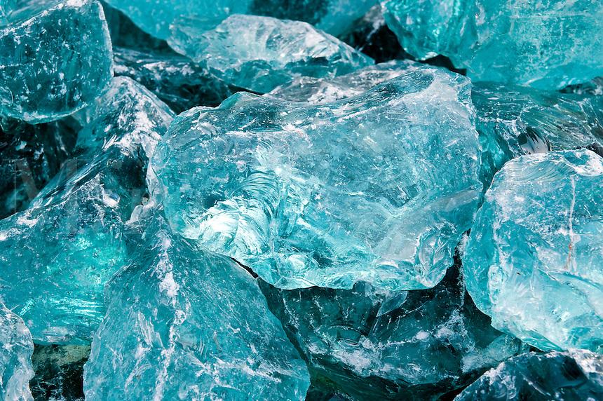 Chunks of raw aquamarine glass.