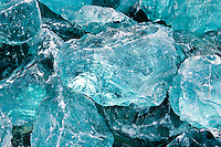 Chunks of raw aquamarine glass.