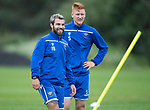 St Johnstone Training….09.08.19<br />Richard Foster all smiles at McDiarmid Park this morning during a very wet and windy training session pictured with Madis Vihmann<br />Picture by Graeme Hart.<br />Copyright Perthshire Picture Agency<br />Tel: 01738 623350  Mobile: 07990 594431