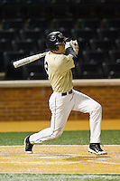 Mark Rhine (2) of the Wake Forest Demon Deacons follows through on his swing against the North Carolina State Wolfpack at Wake Forest Baseball Park on March 15, 2013 in Winston-Salem, North Carolina.  The Wolfpack defeated the Demon Deacons 12-6.  (Brian Westerholt/Four Seam Images)