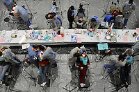 The Remote Area Medical (RAM) dental area handles 30 patients at a time. All dentists and dental assistants are volunteers. Over the weekend at Soft Shell, Knott County, in the Appalachian mountains of eastern Kentucky, the congressional district with the nation's lowest life expectancy, RAM volunteers saw 822 needy people. 95 percent of people seen were provided with dental or optical care. RAM was founded in 1985 to provide free health, dental and eye care in the developing world. However, RAM now provides 60 percent of its services in the US, providing for the estimated 47 million Americans without health insurance..