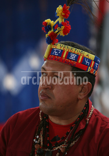 Venezuelan President Hugo Chavez wears indigenous costumes during the celebration of the Indigenous Peoples Day, in opposition to the celebration of the discovery of America in 1492.