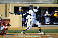 Joseph Burns (4) of the Quinnipiac Bobcats follows through on his swing against the Radford Highlanders at David F. Couch Ballpark on March 4, 2017 in Winston-Salem, North Carolina. The Highlanders defeated the Bobcats 4-0. (Brian Westerholt/Four Seam Images)