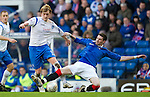 Rangers v St Johnstone....27.02.11 .Liam Craig is brought down by Kyle Lafferty.Picture by Graeme Hart..Copyright Perthshire Picture Agency.Tel: 01738 623350  Mobile: 07990 594431