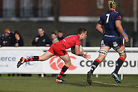 Kieran Hardy of Jersey Reds scores his first try of the game to make the score 0-15 during the Greene King IPA Championship match between London Scottish Football Club and Jersey at Richmond Athletic Ground, Richmond, United Kingdom on 18 February 2017. Photo by David Horn / PRiME Media Images.