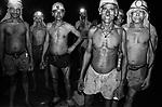 A dangal (group) of miners standing inside an underground mine. North Searsole Coliery in Ranigunj, West Bengal, India. Arindam Mukherjee