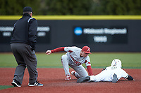 Arkansas Razorbacks shortstop Jax Biggers (9) applies the tag to Tommy Bullock (9) of the Charlotte 49ers as second base umpire Jamie Roebuck looks on at Hayes Stadium on March 21, 2018 in Charlotte, North Carolina.  The 49ers defeated the Razorbacks 6-3.  (Brian Westerholt/Four Seam Images)