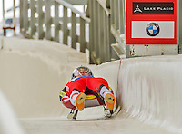5 December 2014: Reinhard Egger, sliding for Austria, crosses the finish line on his first run, ending the day with a 13th place finish and a combined 2-run time of 1:43.706 in the Men's Competition at the Viessmann Luge World Cup, at the Olympic Sports Track in Lake Placid, New York, USA. Mandatory Credit: Ed Wolfstein Photo *** RAW (NEF) Image File Available ***