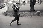 Man walking  with dog Hyde Park London UK 1979, 1970s,