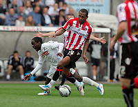 Pictured: Lee Williamson of Sheffield United (R) commits a foul against Nathan Dyer of Swansea (L). Saturday 07 May 2011<br /> Re: Swansea City FC v Sheffield United, npower Championship at the Liberty Stadium, Swansea, south Wales.
