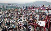 A view of the port of Hong Kong, China, 07 April 2009. Asian shipping shares slumped Tuesday, reflecting a decrease in global demand for commodities and an industry suffering from excess capacity due to the global downturn in trade..