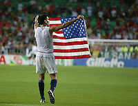 Claudio Reyna holds an American flag after a hard-fought match. The USA lost to Germany 1-0 in the Quarterfinals of the FIFA World Cup 2002 in South Korea on June 21, 2002.