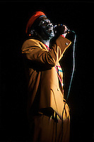 """Montreal (Qc) CANADA - 1990 File Photo -<br /> <br /> Joe Higgs, in concert at the Spectrum, Montreal .<br /> <br /> Joe Higgs (June 3, 1940 › December 18, 1999) was a reggae musician from Jamaica. In the 1960s he was part of the duo Higgs and Wilson together with Roy Wilson.<br /> <br /> Higgs knew Bob Marley from the early 1960s. In fact, Marley acknowledged later on that he had been an influential figure for him. Most people interested in classical reggae do not recognize his name, however Higgs has been regarded as the """"Father of Reggae' by Jimmy Cliff. For a while Higgs toured with Cliff as well as The Wailers when Bunny Wailer refused to go on the tour in mid 1970s while The Wailers were having disputes.<br /> <br /> A majority of Higgs' songs were connected to his impoverished life in Trenchtown where he grew up. Higgs considered that it was out of the poverty and violence of Kingston's shantytowns such as Trenchtown and Johnstown that the reggae music had grown. Before reggae hit big on the western music scene with Bob Marley, it was understood as a """"ghetto music"""". Higgs was the very first artist out the ghetto music scene to have lyrics which primarily dealt with every day troubles.<br /> <br /> -Photo (c)  Images Distribution"""