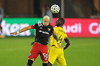 WASHINGTON, DC - OCTOBER 28: Erick Sorga #50 of D.C. United heads the ball against Jonathan Mensah #4 of Columbus Crew SC during a game between Columbus Crew and D.C. United at Audi Field on October 28, 2020 in Washington, DC.