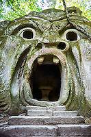 "sculpture of Orcus (l'orco) king of the underworld, with an incription""abondon all reason ye who enter here"", a refernece from Dantes Inferno, commissioned by Piaer Francesco Orsini c. 1513-84, The Renaissance Mannerist statues of the Park of Monsters or The Sacred Wood of Bamarzo, Italy"