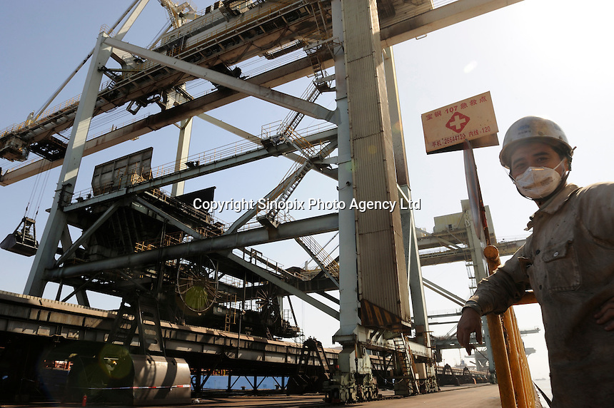 Dock at Shanghai Baosteel factory. Baosteel is the largest Chinese iron and steel conglomerate. It is a state-owned enterprise, headquartered in Shanghai..