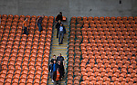 Home fans making their way out of the near-deserted Bloomfield Road stadium after Blackpool hosted Portsmouth in an English League One fixture. The match was proceeded by a protest by around 500 home fans against the club's controversial owners Owen Oyston, many of whom did not attend the game. The match was won by the visitors by 2-1 with two goals by Ronan Curtis watched by just 4,154 almost half of which were Portsmouth supporters.