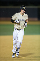 Keegan Maronpot (13) of the Wake Forest Demon Deacons rounds the bases after hitting a grand slam against the Davidson Wildcats at David F. Couch Ballpark on February 28, 2017 in Winston-Salem, North Carolina.  The Demon Deacons defeated the Wildcats 13-5.  (Brian Westerholt/Four Seam Images)