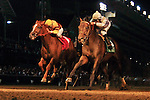 Ron The Greek,(white cap,inside) ridden by Jose Lezcano and trained by William Mott  catch Wise Dan at the wire to win the G1 Stephen Foster Stakes at Churchill Downs in Louisville, Kentucky Saturday June 16, 2012.