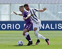 Franck Ribery of Fiorentina  Rodrigo Bentancur of Juventus 1n during the  italian serie a soccer match,Fiorentina - Juventus at  theStadio Franchi in  Florence Italy ,
