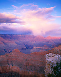 Grand Canyon National Park, AZ<br /> Clearing storm clouds are illuminated at sunset with Cedar Ridge and O'Neill Butte in the foreground from the South Rim at Mather Point