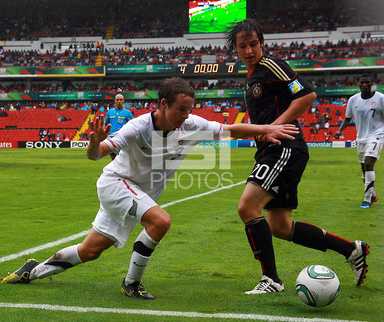 .Action photo of Fabian Schnellhardt (R) of Germany and Nathan Smith (L) of USA, during game of the FIFA Under 17 World Cup game, held at Queretaro.
