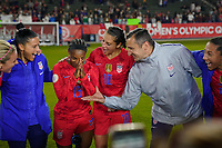 CARSON, CA - FEBRUARY 7: Crystal Dunn #19 celebrates with Carli Lloyd #10 and United States head coach Vlatko Andonovski after the match during a game between Mexico and USWNT at Dignity Health Sports Park on February 7, 2020 in Carson, California.