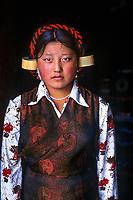 Kham, Tibet 2005. Tibetan woman in head gear, tagong, Kham, Tibet, 2005