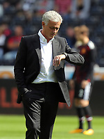 Manchester United manager Jose Mourinho checks the time on his watch during the English Premier League soccer match between Swansea City and Manchester United at Liberty Stadium, Swansea, Wales, UK. Saturday 18 August 2017