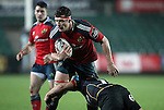Robin Copeland of Munster Rugby is tackled by Open-side flanker Nic Cudd of Newport Gwent Dragons.<br /> <br /> Guiness Pro 12<br /> Newport Gwent Dragons v Munster Rugby<br /> Rodney Parade<br /> 21.11.14<br /> ©Steve Pope-SPORTINGWALES