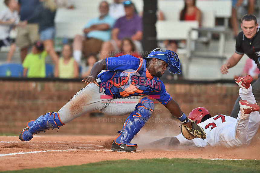 Kingsport Mets catcher Darryl Knight (22) attempts to apply the tag as Magneuris Sierra (37) slides in safely and home plate umpire Ryan Barneycastle prepares to make the call during a game against the  Johnson City Cardinals on June 25, 2015 in Johnson City, Tennessee. The Mets defeated the Cardinals 10-8 (Tony Farlow/Four Seam Images)