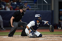 Hudson Valley Renegades catcher Anthony Seigler (20) sets a target as home plate umpire Tyler White looks on during the game against the Wilmington Blue Rocks at Dutchess Stadium on July 27, 2021 in Wappingers Falls, New York. (Brian Westerholt/Four Seam Images)