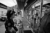 """War, WV, October 25 2008.Zephyr, 78, left and her son Grover, 50, right, in front of Sam's Pizza place during a children Halloween party. """"West Virginia Southernmost city"""", War is a small coal miners' town, hit hard by the economic crisis; many of its inhabitants will vote for Obama as McCain is perceived to be the man from the oil companies, trying to destroy the coal mining industry."""