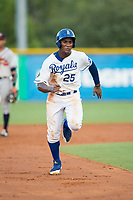 Seuly Matias (25) of the Burlington Royals hustles towards third base against the Danville Braves at Burlington Athletic Stadium on August 12, 2017 in Burlington, North Carolina.  The Braves defeated the Royals 5-3.  (Brian Westerholt/Four Seam Images)