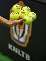 21-12-13,Netherlands, Rotterdam,  Topsportcentrum, Tennis Masters, Dunlop balls and KNLTB logo<br /> Photo: Henk Koster
