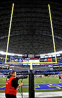 3 December 2009: A photographer stands ready in the end zone prior to a game between the Buffalo Bills and the New York Jets at the Rogers Centre in Toronto, Ontario, Canada. The Jets defeated the Bills 19-13. Mandatory Credit: Ed Wolfstein Photo