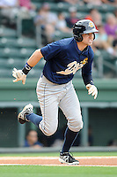Center fielder Jake Cave (6) of the Charleston RiverDogs in a game against the Greenville Drive on Sunday, May 19, 2013, at Fluor Field at the West End in Greenville, South Carolina. Charleston won, 9-7. (Tom Priddy/Four Seam Images)