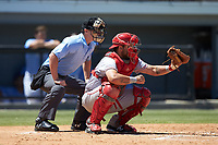 Greeneville Reds catcher Hunter Oliver (28) catches a pitch as home plate umpire Kyle Stutz looks on during the game against the Burlington Royals at Burlington Athletic Stadium on July 8, 2018 in Burlington, North Carolina. The Royals defeated the Reds 4-2.  (Brian Westerholt/Four Seam Images)