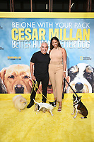 """LOS ANGELES - JULY 30: Cesar Millan and Kamie Crawford attend the premiere event for National Geographic's """"Cesar Millan: Better Human, Better Dog"""" at the Westfield Century City Mall Atrium on July 30, 2021 in Los Angeles, California. (Photo by Stewart Cook/National Geographic/PictureGroup)"""