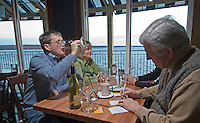 A customer finishes off his glass of wine as his dining partner signs the credit card bill on opening day at Hoover Grill  in Westerville, Ohio, Wednesday, Feb. 1, 2006. The restaurant on the banks of Hoover Reservoir is one of several new alcohol sales permits in the city, home to the Anti-Saloon League. Alcohol was last served in the city more than 120 years ago.<br />